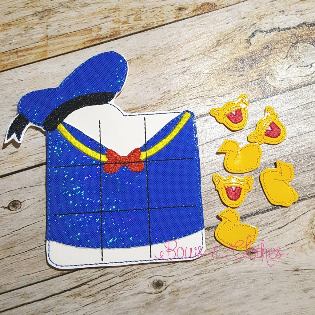 Mr Duck Tic Tac Toe And Pieces Bows And Clothes